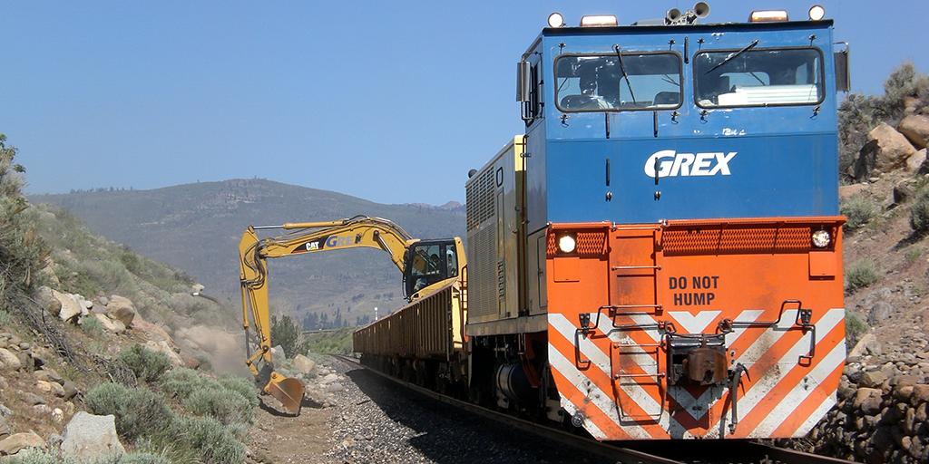 Train car and excavator