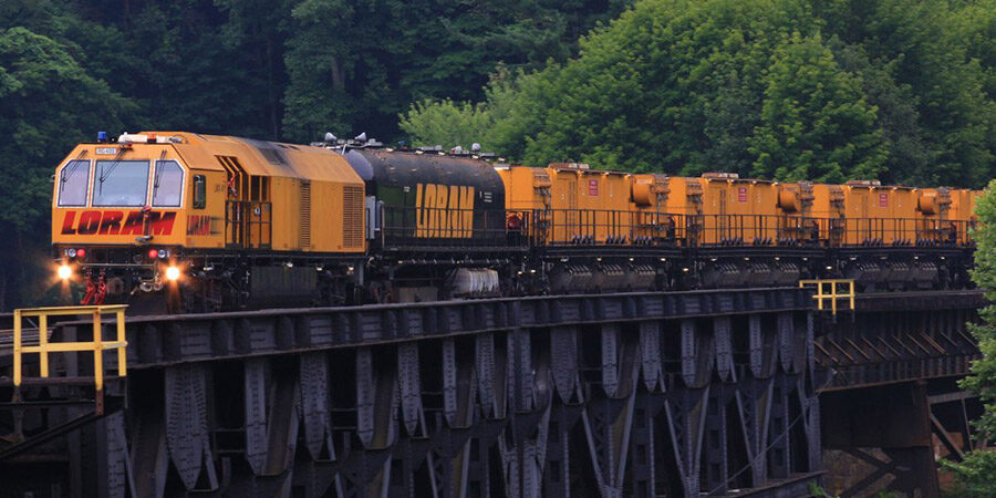 LORAM carts driving through wooded area
